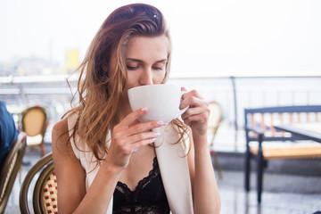 girl drink in cafe