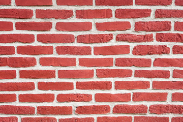 Decorative pattern red brick wall background.