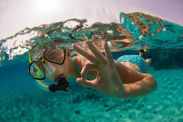 Snorkeling woman exploring beautiful ocean sealife, underwater photography.