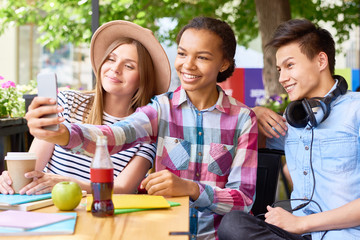 Joyful Young People Taking Selfie in Cafe