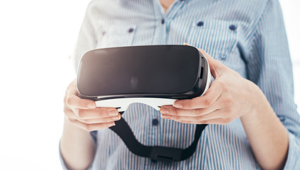 Woman holding a VR headset