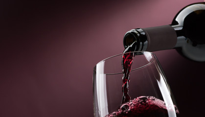 Printed kitchen splashbacks Wine Pouring red wine into a wineglass