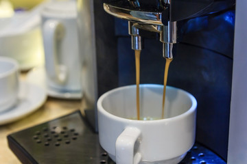 Coffee machine preparing fresh coffee espresso and pouring into white cups, Professional coffee brewing, drink and coffee shop concept, as background or print.