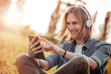 Man using tablet to listen to music.