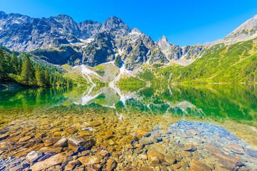 Obraz View of Morskie Oko lake with emerald green water in summer season, High Tatra Mountains, Poland - fototapety do salonu