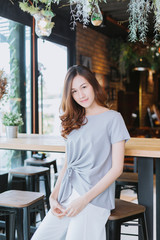 portrait of beautiful asian girl with beautiful waring in coffee shop. cute girl concept.