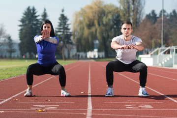 Young Couple Exercising Outside
