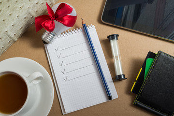 Mix of office supplies and business gadgets on office desk