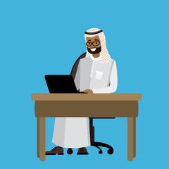Arabic businessman working at a laptop