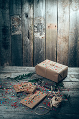 Christmas gift pack with rustic background