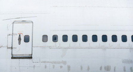 the side of airplane have the door and many window