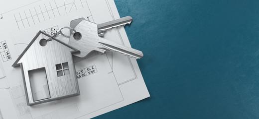 Chiavi di casa con progetto in sfondo