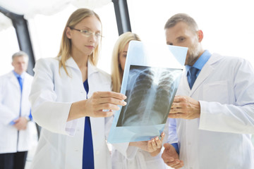 Group of medics with x-ray scan