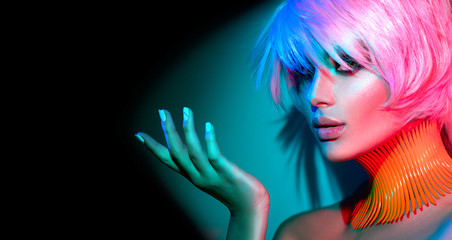 Photo sur Plexiglas Salon de coiffure Fashion model woman in colorful bright lights, portrait of beautiful party girl with trendy makeup, manicure and haircut