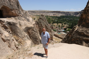An English tourist visiting the Selime Monastery in Cappadocia, which is one of the largest religious buildings in Cappadocia. 2017