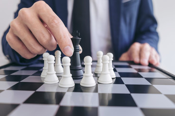 Close up of hands confident businessman playing chess game to development analysis new strategy plan, leader and teamwork concept for success