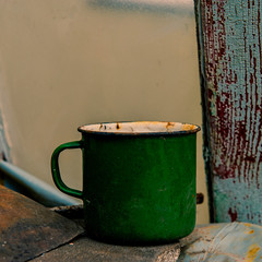 Abandoned old metal mug