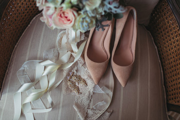 Wedding bouqet with shoes in the chair