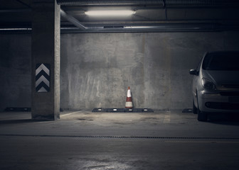 Urban underground background with the lamp light in the dark and a car.