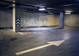 Empty dark abstract concrete room interior with white arrow. Architectural background