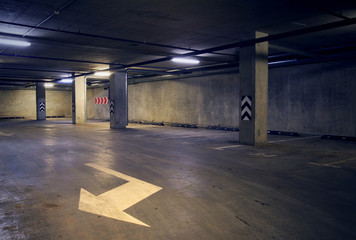 Urban underground background with white arrow on the ground