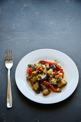 Vegetable stew on white plate