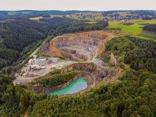 Aerial of an asphalt opencast mine in Reichshof - Germany