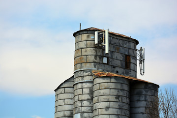 Cell Tower on an Old Antique Agricultural Grain Elevator Silo