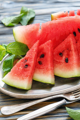 Dish with slices of ripe red watermelon.