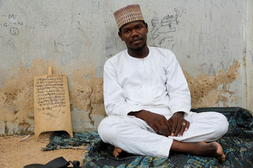 Sadiq Ismail, a Koranic teacher, poses for a picture at Yahaya Ismail Quranic school in Kano