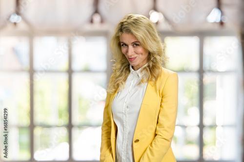 Attractive Shy Sexy Model Posing In Studio Wearing Gray