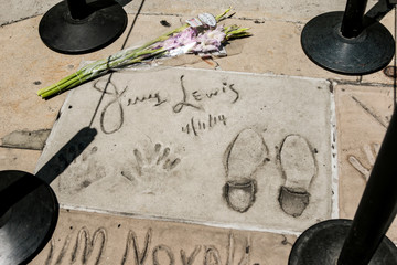 A makeshift memorial appears for late comedian, actor and legendary entertainer Jerry Lewis around his hand and feet prints on the Hollywood Walk of Fame in Los Angeles.