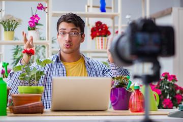 Man florist gardener vlogger blogger shooting video on camera