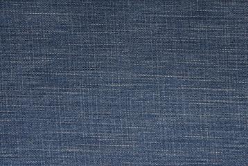 blue denim background, jeans fabric, close-up of jeans textile