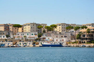 Blue water of Brindisi port with ships, Apulia, Italy