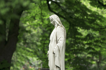 Wall Mural - Virgin Mary statue. Vintage sculpture of sad woman in grief (Religion, faith, suffering, love concept)