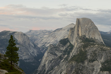 North Dome, Tenaya Canyon, Half Dome and Cloud's Rest at sunset as seen from Glacier Point, Yosemite, California, USA
