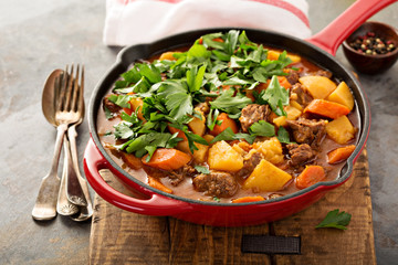 Stewed beef with potatoes, carrot and parsley
