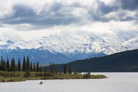 Kayak in Wonder Lake with Mt. McKinley in the background, Denali National Park Alaska, USA.