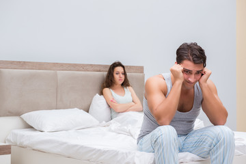 Family conflict with wife and husband in bed