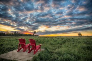 Fotomurales - Red Chairs Before Beautiful Sunrise in Elk Island Park