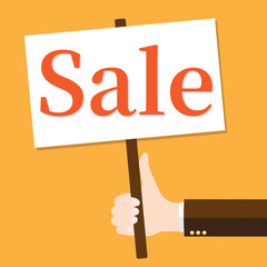 Hand holds sale sign