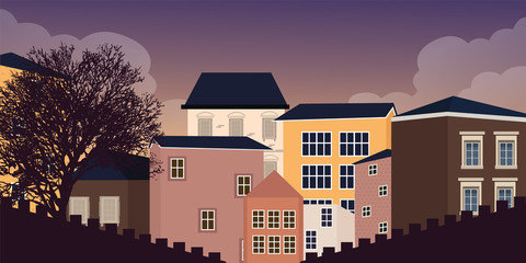 Europe style home residential in village town house old window in the night dark sky with tree silhouette vintage exterior facade