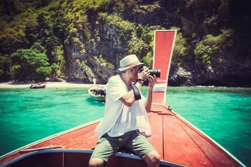 Happy men traveling on boat, Krabi Thailand