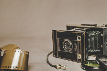 Old vintage retro camera still life on fabric background close up