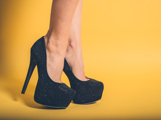 Sexy legs of woman wearing black heels