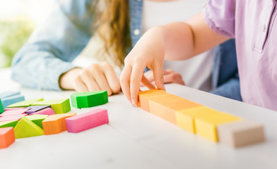 Child playing with wood blocks