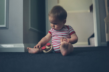 Little baby playing on floor at home