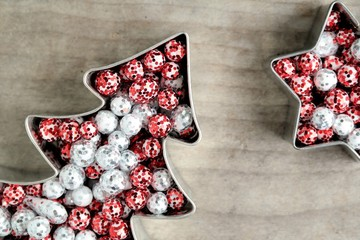 christmas baking molds on wooden background, x-mas tree and star with text space