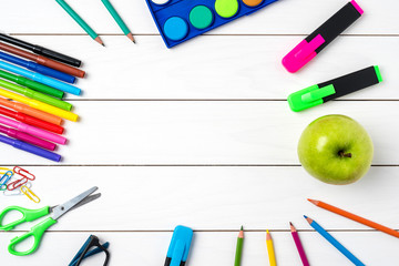 School supplies on white wooden table. Back to school concept